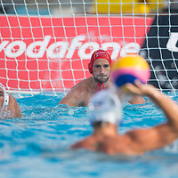 Goalkeeper Inaki Aguilar (back C) of Spain prepares to save a goal during the Vodafone Waterpolo Cup in Budapest, Hungary on July 15, 2012. ATTILA VOLGYI