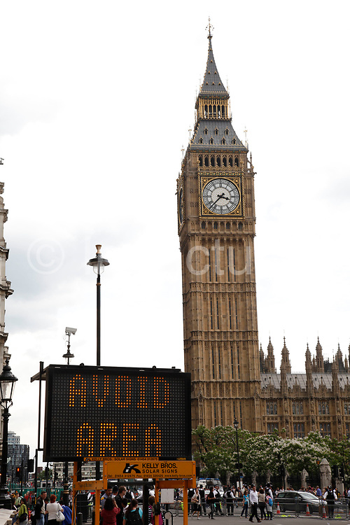 A roadworks sign in Westminster warms motorists to Avoid Area. Ironically with the backdrop of Big Ben and the Houses of Parliament this takes on a more ironic meaning, especially in a time where politics and poitical disasters are happening every day.