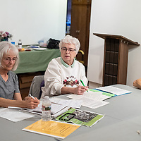 From left to right, Linda Popelish, Millie Dunning and Sandi Young talk with other members of the McKinley Citizen's Recycling Council Monday afternoon in Gallup about their goal for the year on the plastic straw restriction.
