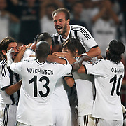 Besiktas's players celebrate goal during the UEFA Europa League Play Offs Second leg soccer match Besiktas between Tromso at Ataturk Olimpiyat stadium in Istanbul Turkey on Thursday August 29, 2013. Photo by Aykut AKICI/TURKPIX
