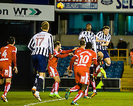 Fred Onyedinma and Lee Gregory of Millwall both attempt a header on goal during the Sky Bet League 1 match at The Den, London<br /> Picture by Richard Brooks/Focus Images Ltd 07947656233<br /> 21/02/2017