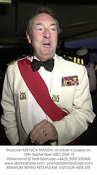 Musician MR NICK MASON, at a ball in Sussex on 15th September 2001.			OSH 15