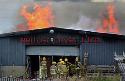 File photo dated 1/7/2017 of fire crews tackle a factory fire at Belfast Crystal, on Blackstaff Road in Kennedy Way industrial estate in West Belfast.