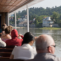 Passengers enjoy the view of the bend of River Danube from a boat after the ease of the COVID-19 restrictions near Zebegeny, Hungary on June 29, 2020. ATTILA VOLGYI