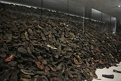 Shoes in display case in Block 5 at Auschwitz-Birkenau Memorial and Museum in Auschwitz, Poland on September 3, 2017. Auschwitz concentration camp was a network of German Nazi concentration camps and extermination camps built and operated by the Third Reich in Polish areas annexed by Nazi Germany during WWII. It consisted of Auschwitz I (the original camp), Auschwitz II–Birkenau (a combination concentration/extermination camp), Auschwitz II–Monowitz (a labor camp to staff an IG Farben factory), and 45 satellite camps. In September 1941, Auschwitz II–Birkenau went on to become a major site of the Nazi Final Solution to the Jewish Question. From early 1942 until late 1944, transport trains delivered Jews to the camp's gas chambers from all over German-occupied Europe, where they were killed en masse with the pesticide Zyklon B. An estimated 1.3 million people were sent to the camp, of whom at least 1.1million died. Around 90 percent of those killed were Jewish; approximately 1 in 6 Jews killed in the Holocaust died at the camp. Others deported to Auschwitz included 150,000 Poles, 23,000 Romani and Sinti, 15,000 Soviet prisoners of war, 400 Jehovah's Witnesses, and tens of thousands of others of diverse nationalities, including an unknown number of homosexuals. Many of those not killed in the gas chambers died of starvation, forced labor, infectious diseases, individual executions, and medical experiments. In 1947, Poland founded a museum on the site of Auschwitz I and II, and in 1979, it was named a UNESCO World Heritage Site. Photo by Somer/ABACAPRESS.COM