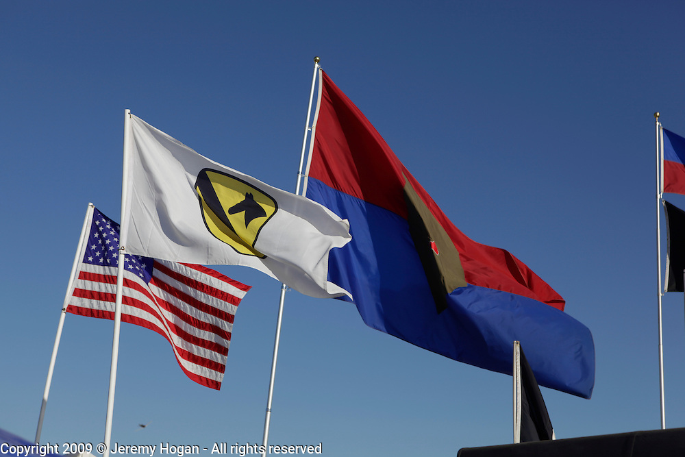 1st Cavalry and 1st Infantry flags fly during the Vietnam Veterans gathering in Kokomo, Indiana for the 2009 reunion.