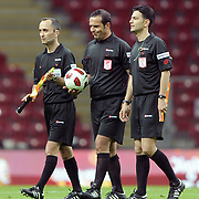 Referee's Bunyamin GEZER (C) during their Turkish superleague soccer derby match Galatasaray between Trabzonspor at the TT Arena in Istanbul Turkey on Sunday, 10 April 2011. Photo by TURKPIX