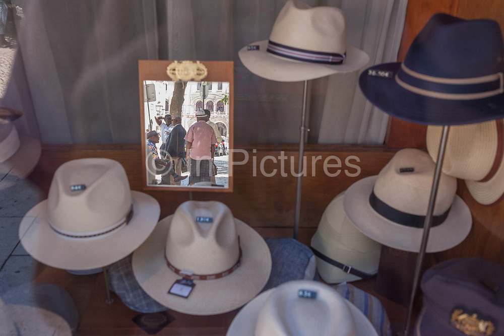 Hats of all sizes and varieties on display in the window of  Chapelaria Azevedo Rua, on 13th July 2016, in Lisbon, Portugal. Manuel Aquino Azevedo Rua founded the shop in 1886 when he left winemaking Port. It is now owned by the fifth generation of the same family.