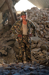 KABUL,AFGHANISTAN - SEPT. 12: Nazir Mohammad stands inside the ruins of the former Presidential Palace  in Kabul, Afghanistan September 12,2002.   (Photo by Ami Vitale/Getty Images)