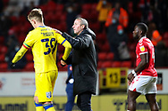 Charlton Athletic manager Lee Bowyer with hand on shoulder of AFC Wimbledon striker Joe Pigott (39) during the EFL Sky Bet League 1 match between Charlton Athletic and AFC Wimbledon at The Valley, London, England on 12 December 2020.
