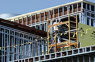 Newburgh, New York - A man works on a platform as construction continues on Kaplan Hall at Orange County Community College's Newburgh campus on March 17, 2010. Kaplan Hall will be a state-of-the-art, environmentally friendly building.