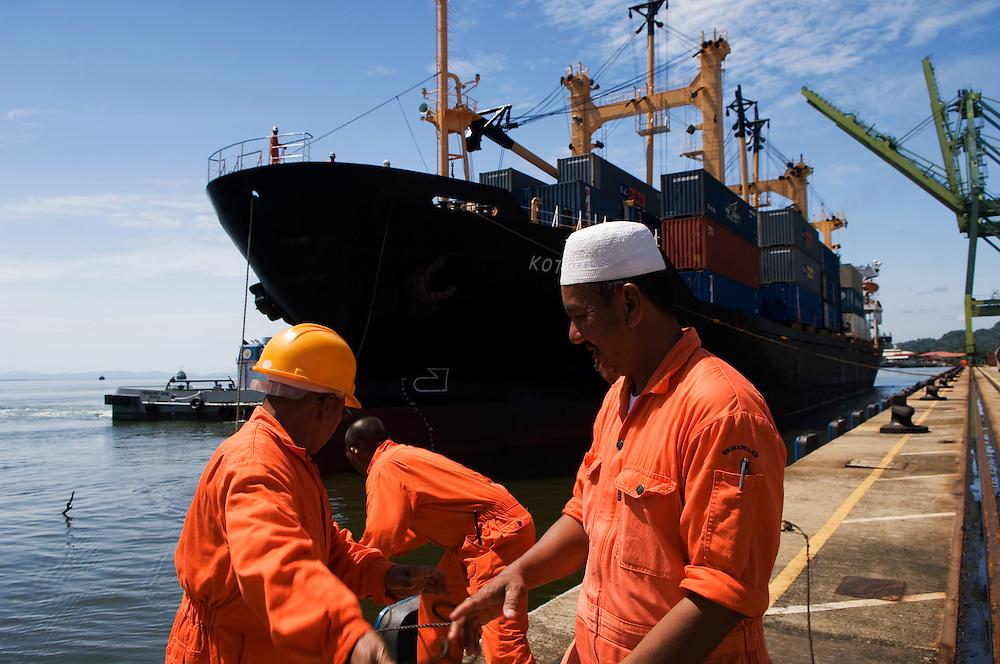 Dock workers moor a huge container ship, Muara, Brunei