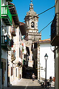 Iglesia de Santa Maria de la Asuncion church and alleyway, old town Hondarribia, Basque Country, Spain
