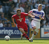 Photo: Lee Earle.<br /> Queens Park Rangers v Cardiff City. Coca Cola Championship. 21/04/2007.Cardiff's Michael Chopra (L) holds off Martin Rowlands.