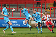 Cheltenham Town Midfielder Matty Blair(11) heads the ball  during the EFL Sky Bet League 2 match between Stevenage and Cheltenham Town at the Lamex Stadium, Stevenage, England on 20 April 2021.