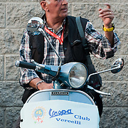 MILAN, ITALY - JUNE 05:  A participant gets ready for the start of the Vespa race on June 5, 2010 in Milan, Italy. Vespa is one of the best known Italian icons, the special Vespa weekend is the XV edition of the famous  500km night race  (Photo by Marco Secchi/Getty Images)