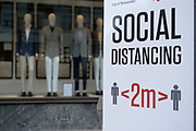 Social distancing signs on Regent Street under coronavirus lockdown on 1st July 2020 in London, England, United Kingdom. As the July deadline approaces and government will relax its lockdown rules further, the central London remains very quiet, while some non-essential shops are allowed to open with individual shops setting up social distancing systems.