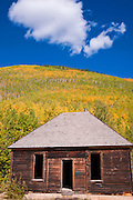 Mining cabin and fall color on the San Juan Skyway (Highway 550), Uncompahgre National Forest, Colorado
