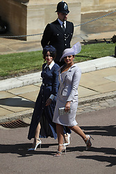 Suits actress Abigail Leigh Spencer and Bollywood actress Priyanka Chopra (right) arrive at St George's Chapel in Windsor Castle for the wedding of Prince Harry and Meghan Markle.