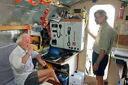 06 April 2011. St Maarten, Antilles, Caribbean.<br /> Crew members John Russell (l) and Dr Andrew Bainbridge.<br /> Crew of the Antiki raft arrive in the islands following their epic 9 week trans-Atlantic journey from the Canary islands.  Conditions aboard the very cramped 'Antiki'. The toilet ('room with a view'), shower, emergency raft on the raft! And the cramped living quarters, bunks, radio and satellite equipment, books, cooking facilities, and personal effects.<br /> Crew; Anthony Smith (84 yrs old) British adventurer, John Russell, solicitor and UK resident, David Hildred, sailing master and British Virgin Islands resident,  Dr Andrew Bainbridge of Alberta, Canada.<br /> Photo; Charlie Varley/varleypix.com