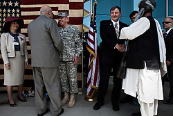 A day before assuming command as the new overall commander in Afghanistan (following the resignation of Gen. Stanley McChrystal), Gen. David Petraeus attends an event to celebrate the Fourth of July (on July 3rd) hosted by US Ambassador to Afghanistan Karl Eikenberry at the US Embassy in Kabul. The event was attended by more than a thousand dignitaries, notables, journalists, service-members, businessmen, contractors, and a large display of red, white, and blue cupcakes in the shape of an American flag painted yb Jasper Johns. Summer 2010.