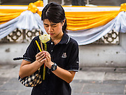 18 OCTOBER 2016 - BANGKOK, THAILAND:  A woman wearing black mourning clothes prays for the late Bhumibol Adulyadej, the King of Thailand, at Wat Bowon Niwet, a Buddhist temple affiliated with the Thai monarchy. The King died Oct. 13, 2016. He was 88. His death came after a period of failing health. Bhumibol Adulyadej was born in Cambridge, MA, on 5 December 1927. He was the ninth monarch of Thailand from the Chakri Dynasty and is also known as Rama IX. He became King on June 9, 1946 and served as King of Thailand for 70 years, 126 days. He was, at the time of his death, the world's longest-serving head of state and the longest-reigning monarch in Thai history.    PHOTO BY JACK KURTZ