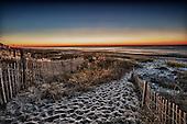Emerald Isle featuring fishing and sunrises