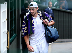 John Isner leaves court after losing to Kevin Anderson 7-6 (8/6) 6-7 (5/7) 6-7 (9/11) 6-4 26-24 in the longest semi-final in the tournament's history on day eleven of the Wimbledon Championships at the All England Lawn Tennis and Croquet Club, Wimbledon.