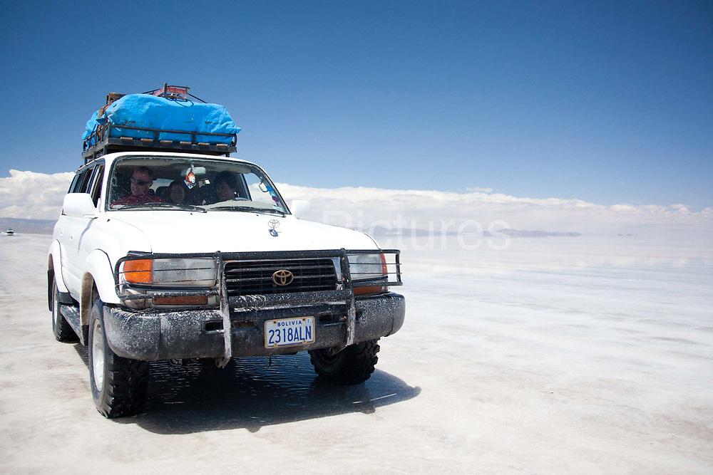 Driving through the largest salt flats in the World - Salar Uyuni salt flats and Eduardo Avaroa national park, south western Bolivia