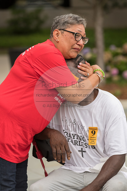 Family members of Ethel Lance, killed in the Mother Emanuel African Methodist Episcopal Church shooting comfort each other during the unveiling of a memorial marker on the 2nd anniversary of the mass shooting June 17, 2017 in Charleston, South Carolina. Nine members of the historic African-American church were gunned down by a white supremacist during bible study on June 17, 2015.