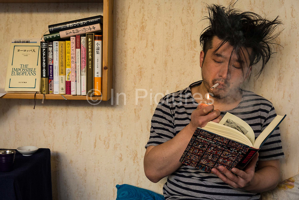 Masatsugu Okutani, 41 relaxes reading a book at home in Paris before heading off to the offices of the Japanese food company Ajinomoto for whom he is the Marketing manager responsible for the Cos sales throughout Europe.