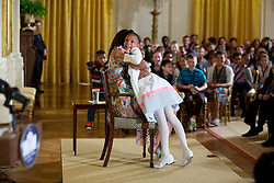 """First Lady Michelle Obama hugs a child attending the annual """"Take Our Daughters and Sons to Work Day"""" event in the East Room of the White House, April 22, 2015. (Official White House Photo by Lawrence Jackson)<br /> <br /> This official White House photograph is being made available only for publication by news organizations and/or for personal use printing by the subject(s) of the photograph. The photograph may not be manipulated in any way and may not be used in commercial or political materials, advertisements, emails, products, promotions that in any way suggests approval or endorsement of the President, the First Family, or the White House."""