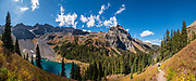 Hiking above Lower Blue Lake, in Mt Sneffels Wilderness, Uncompahgre National Forest, San Juan Mountains, near Ridgway, Colorado, USA. This image was stitched from multiple overlapping photos.