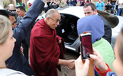 The Dalai Lama visits Cambridge to attend a press conference hosted by Global Scholars Symposium at the Divinity School of St Johns College. He is pictured chatting to shoppers in the street after the conference, Cambridge, UK, Friday April 19,  2013, Photo by: Matthew Power / i-Images