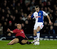 Photo: Jed Wee.<br /> Blackburn Rovers v Manchester United. Carling Cup. Semi Final, 1st Leg. 11/01/2006.<br /> <br /> Blackburn's David Bentley (R) is tackled by Manchester United's Mikael Silvestre.