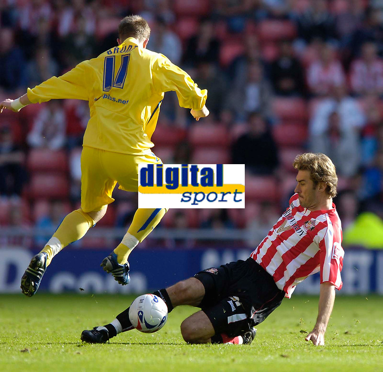 Photo: Jed Wee.<br />Sunderland v Sheffield Wednesday. Coca Cola Championship. 30/09/2006.<br /><br />Sheffield Wednesday's Chris Brunt (L) hurdles over a challenge from Sunderland's Stanislav Varga.