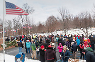 Goshen, New York - People gather at Orange County Veterans Memorial Cemetery before a Wreaths Across America ceremony on Dec. 16, 2017. About 3,000 wreaths were placed at graves, and small American flags were added to the wreaths at veterans' graves.