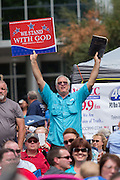 """Evangelical Christians pray during the """"Stand With God"""" rally  August 29, 2015 in Columbia, SC. Thousands of conservative Christians gathered at the State House to rally against gay marriage and listen to GOP presidential candidates Gov. Rick Perry and Sen. Ted Cruz speak."""