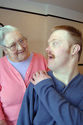Elderly disabled woman is full time carer for her son with Down's Syndrome; Bradford; Yorkshire UK