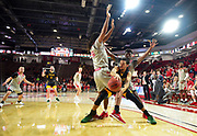 NDSU's Cameron Hunter passes the ball around the bodies of USD's Brandon Armstrong and Triston Simpson on Wednesday, Feb. 19, 2020, at the Sanford Coyote Sports Center in Vermillion.