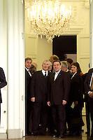 11 JAN 2005, BERLIN/GERMANY:<br /> Wolfgang Clement, SPD, Bundeswirtschaftsminister, Otto Schily, SPD, Bundesinnenminister, Gerhard Schroeder, SPD, Bundeskanzler, Brigitte Zypries, SPD, Bundesjustizministerin, (v.L.n.R.), warten in der Schlange des Defilees, Neujahrsempfang des Bundespraesidenten, Schloss Charlottenburg<br /> IMAGE: 20050111-01-014<br /> KEYWORDS: Bundespräsident, Gerhard Schröder