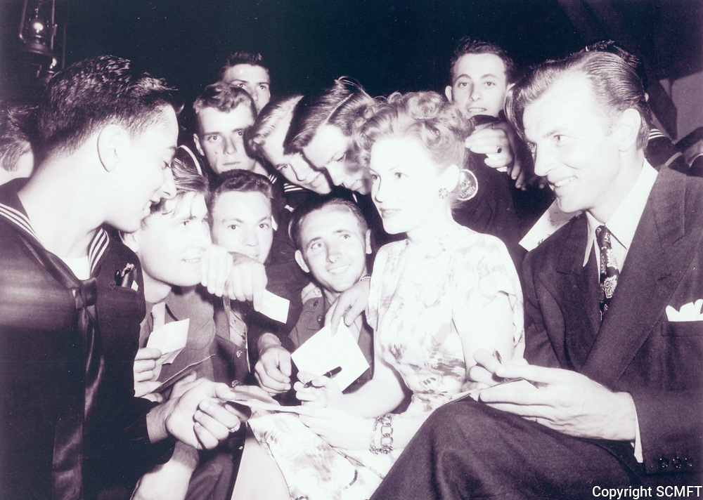 1943 Joan Leslie and Bruce Bennett sign autographs at the Hollywood Canteen