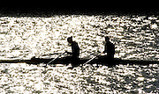 2005 FISA Team Cup, Rio Guadalquiver Rowing Course, Seville, SPAIN, 19.02.2005. Training Day; GBR W2X Sarah Winckless [left] and Kath Grainger. Photo  Peter Spurrier. .email images@intersport-images... Sunrise, Sunsets, Silhouettes