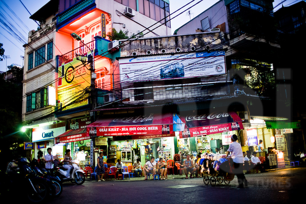 "Tourists drink beer along the ""Bia Hoi Corner"", Hanoi, Vietnam, Southeast Asia"