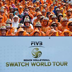 10-07-2011 VOLLEYBAL: FIVB WORLD TOUR BEACHVOLLEYBAL: GSTAAD<br /> Publiek support met regencapes, FIVB Logo Swtch World Tour, illustratief<br /> ©2011-www.FotoHoogendoorn.nl / Peter Schalk