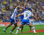 Warrington Wolves Ashton Sims is held by Wakefield Trinity Wildcats Scott Moore during the Ladbrokes Challenge Cup Semi-Final  match Warrington Wolves -V- Wakefield Trinity Wildcats at , Leigh, Greater Manchester, England on Saturday, July 30, 2016. (Steve Flynn/Image of Sport)
