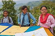 Students from the Shree Bishwamitra Ganesh School enjoy a project organised by the Transcultural Psychosocial Organisation (TPO) in the hills of Lalitpur, Nepal.