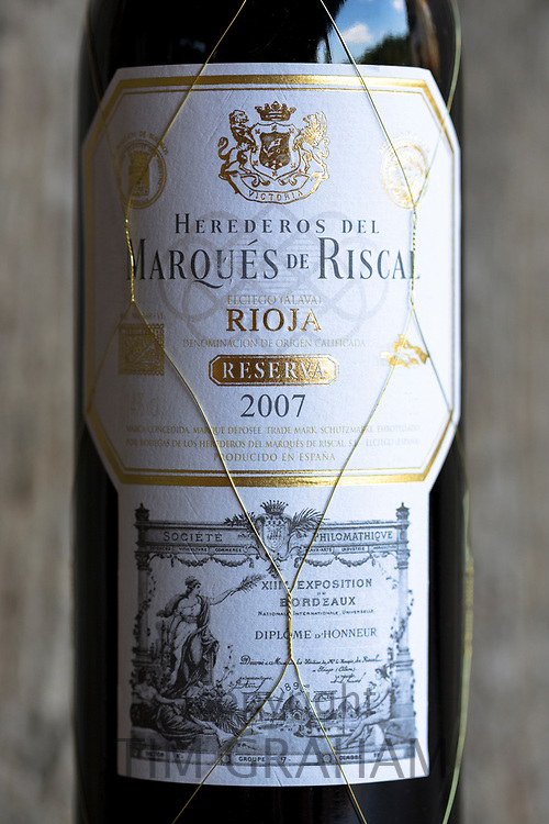 Marques de Riscal Rioja red wine bottles Reserva 2007 vintage by old oak panel, Spain