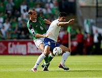 Photo: Andrew Unwin.<br />Northern Ireland v Azerbaijan. FIFA World Cup Qualifying match. 03/09/2005.<br />Azerbaijan's Aslan Kerimov (R) is put under pressure by Northern Ireland's Stuart Elliott (L).
