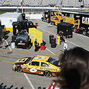 Fans watch as Sprint Cup Series driver David Ragan (6) exits the garage area at Daytona International Speedway on February 18, 2011 in Daytona Beach, Florida. (AP Photo/Alex Menendez)